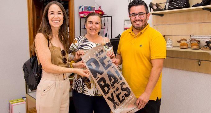 Els comerços de Mislata promocionen les seues rebaixes amb cartells en valencià