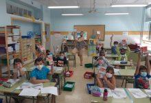 Més de 470 xiquets del Marítim reben material escolar i de protecció en la campanya Aportem-Port Solidari