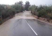 Així està la situació a l'Horta Sud: carrers i accessos tallats per les fortes pluges